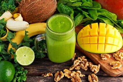 Healthy Green Reach Vitamins Smoothie with baby leaf spinach, kale, mango, banana, lime, walnut and coconut water.
